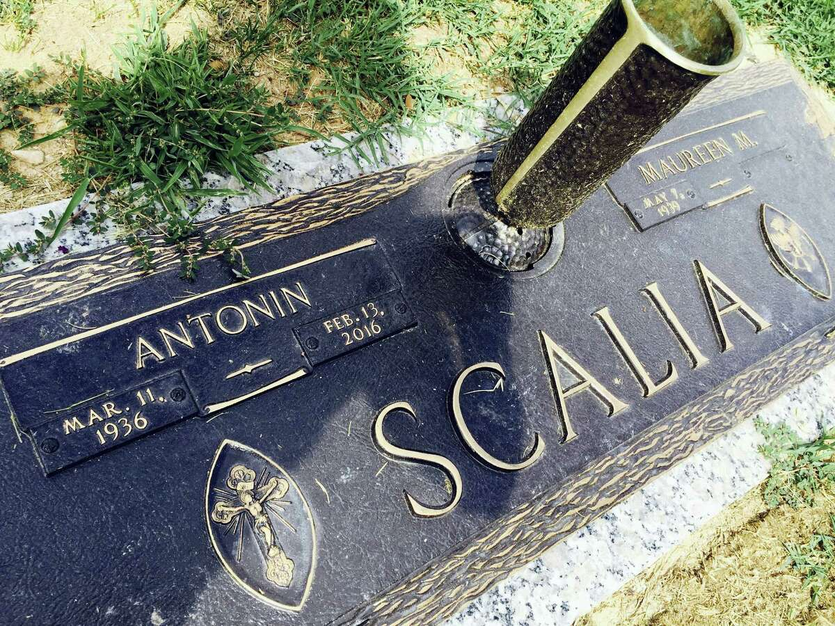 In this photo taken Aug. 14, 2016, the gravesite of Supreme Court Justice Antonin Scalia at Fairfax Memorial Park in Fairfax, Va. Thousands attended Supreme Court Justice Antonin Scalia's funeral in Washington earlier this year, but when the hearse pulled away from the church and headed to his burial site, his family asked for privacy and the Supreme Court declined to say where Scalia was being laid to rest. With the internet's help, however, Scalia's burial spot at Virginia's Fairfax Memorial Park is now public.
