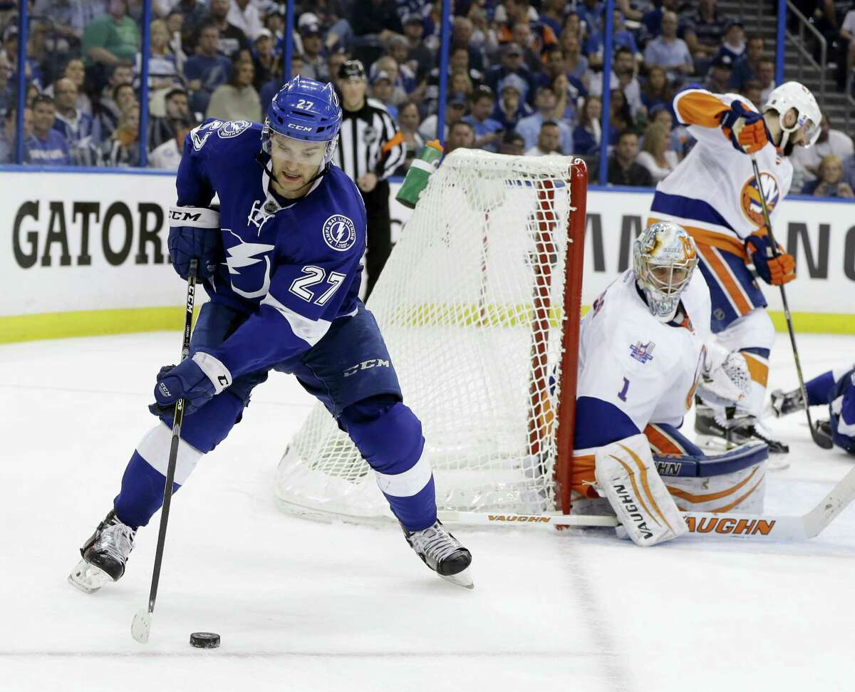 Tampa Bay Lightning left wing Jonathan Drouin controls the puck as Islanders goalie Thomas Greiss defends the net during the second period on Saturday.