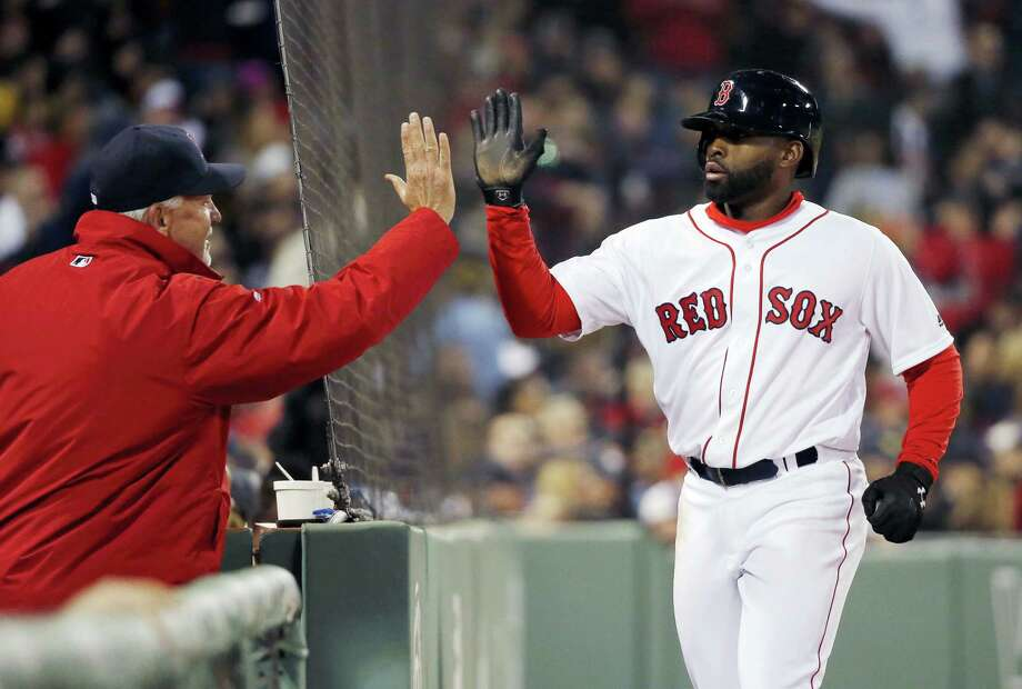 Jackie Bradley Jr., right, celebrates after scoring on a single by Mookie Betts during the sixth inning against the Yankees on Saturday. Photo: Michael Dwyer — The Associated Press  / AP