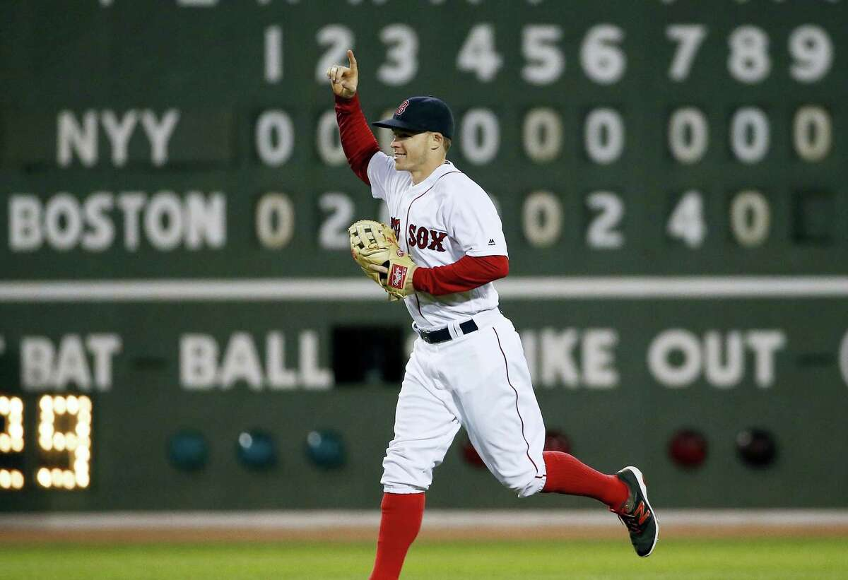 Brock Holt is celebrates after Saturday's win.