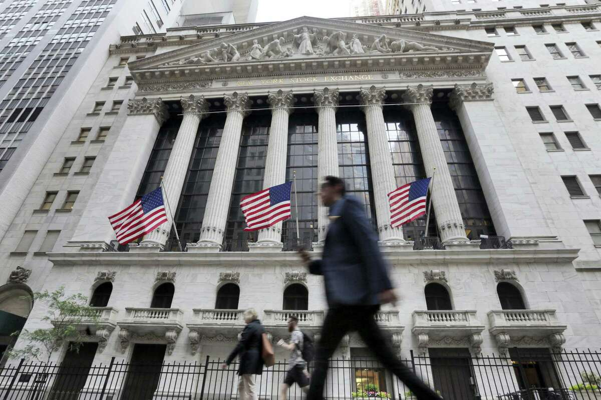 FILE - In this Friday, June 24, 2016, file photo, people walk by the New York Stock Exchange. Global stocks mostly rose Friday, July 1, as authorities stepped in to ease the uncertainty surrounding the British vote to leave the European Union. Investors flocked to equities in the face of narrowing choices for investments amid low or negative interest rates on many bonds.