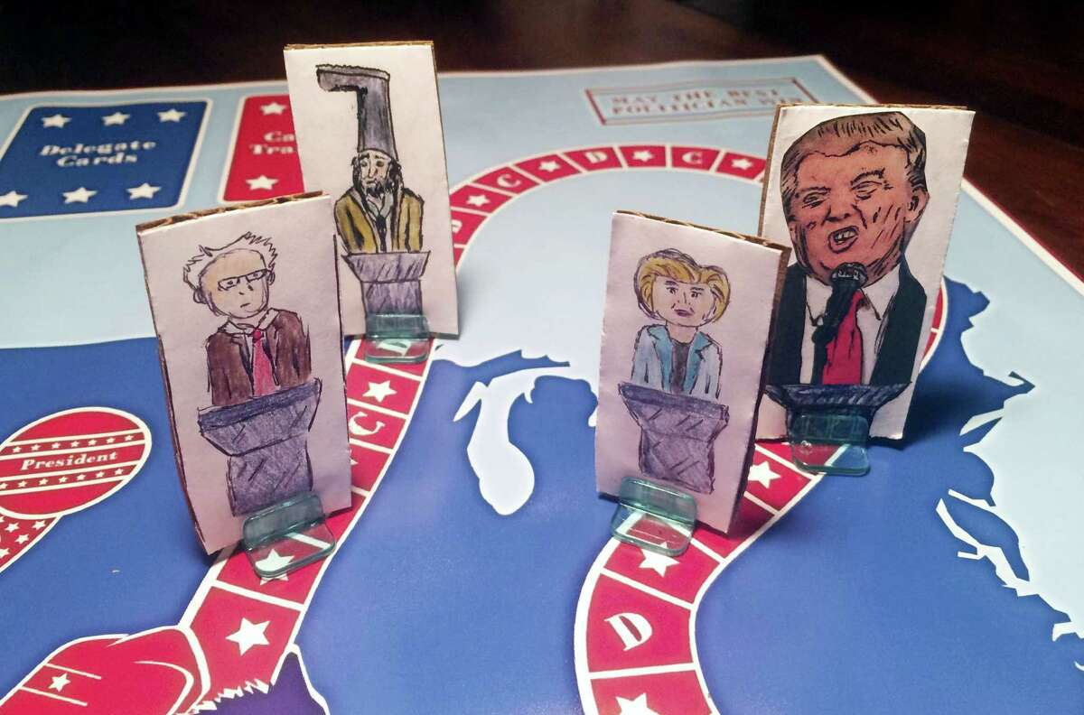 """In this handout photo taken April 20, and provided by Steve Polczwartek, New Hampshire presidential primary candidates are seen on a new board game called """"Trunks 'N Asses"""" developed by Steve Polczwartek and Blake Amacker, co-workers in Keene, N.H. The game features six candidates — Republicans Donald Trump, Ted Cruz and Marco Rubio; Democrats Hillary Clinton and Bernie Sanders; and Vermin Supreme, a performance artist and perennial candidate in the New Hampshire primary."""
