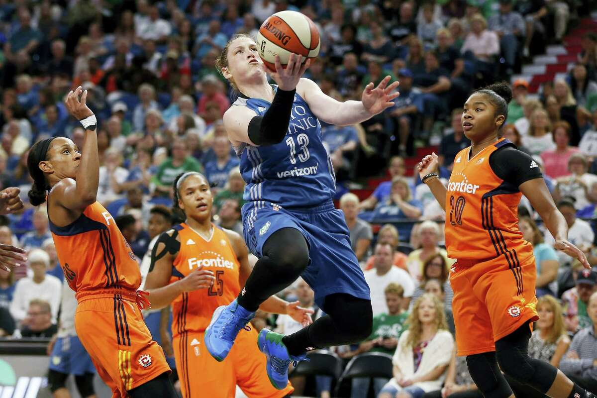 Minnesota Lynx's Lindsay Whalen goes up for a layup during Sunday's game against the Sun.