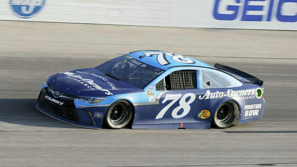 Martin Truex Jr. races into a turn during Sunday's race at Darlington Raceway in South Carolina