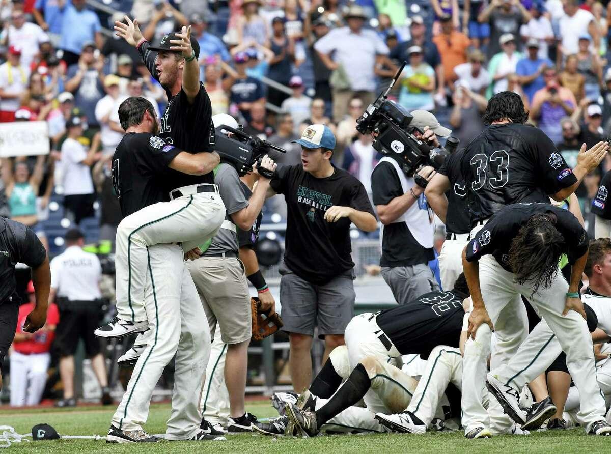 Coastal Carolina players celebrate after beating Arizona to win the College World Series on Thursday.