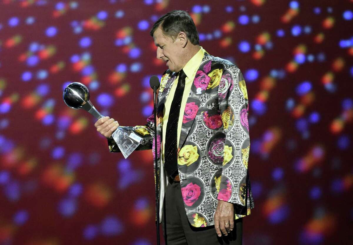 In this July 13, 2016 photo, Craig Sager accepts the Jimmy V award for perseverance at the ESPY Awards at Microsoft Theater in Los Angeles. Sager's son says his father will undergo a third bone marrow and stem cell transplant Aug. 31, 2016 as he continues his cancer fight.