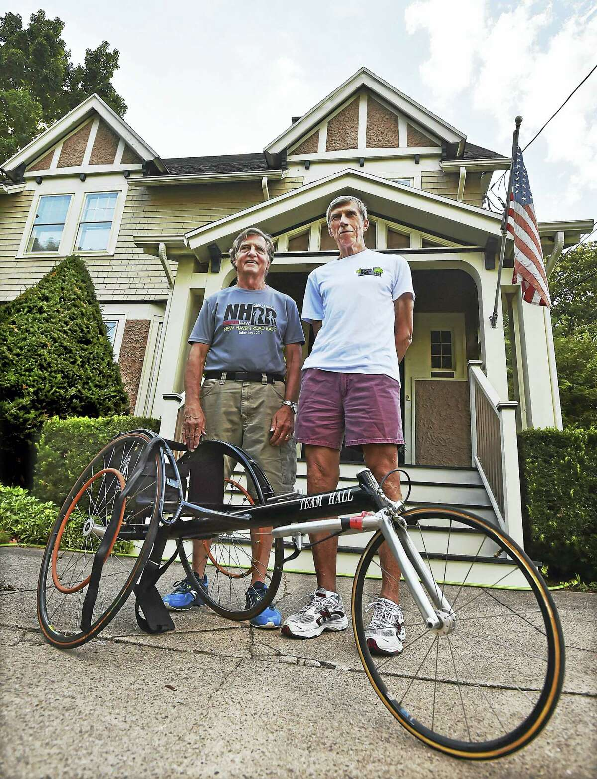 Peter Halsey, left, and Bill Schaeffer, photographed Tuesday, August 30, 2016 outside Halsey's home in New Haven. They are two of 12 runners who have participated every year in the Faxon Law New Haven 20K Road Race. The race, in its 39th year, is on Labor Day, September 5. During two of the races Halsey used this racing wheelchair because he was injured.