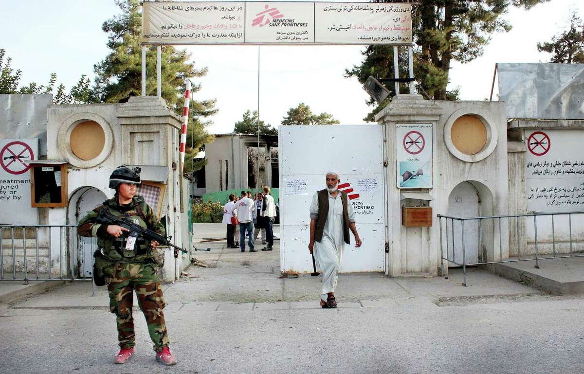 In this Thursday, Oct. 15, 2015 file photo, an Afghan National Army soldier stands guard at the gate of a Doctors Without Borders hospital in Kunduz, Afghanistan. About 16 U.S. military personnel, including a two-star general, have been disciplined for mistakes that led to the bombing of the civilian hospital in Afghanistan last year that killed 42 people, a senior U.S. official said Thursday, April 28, 2016. According to officials, no criminal charges were filed and the service members received administrative punishments in connection with the U.S. airstrike in the northern city of Kunduz.