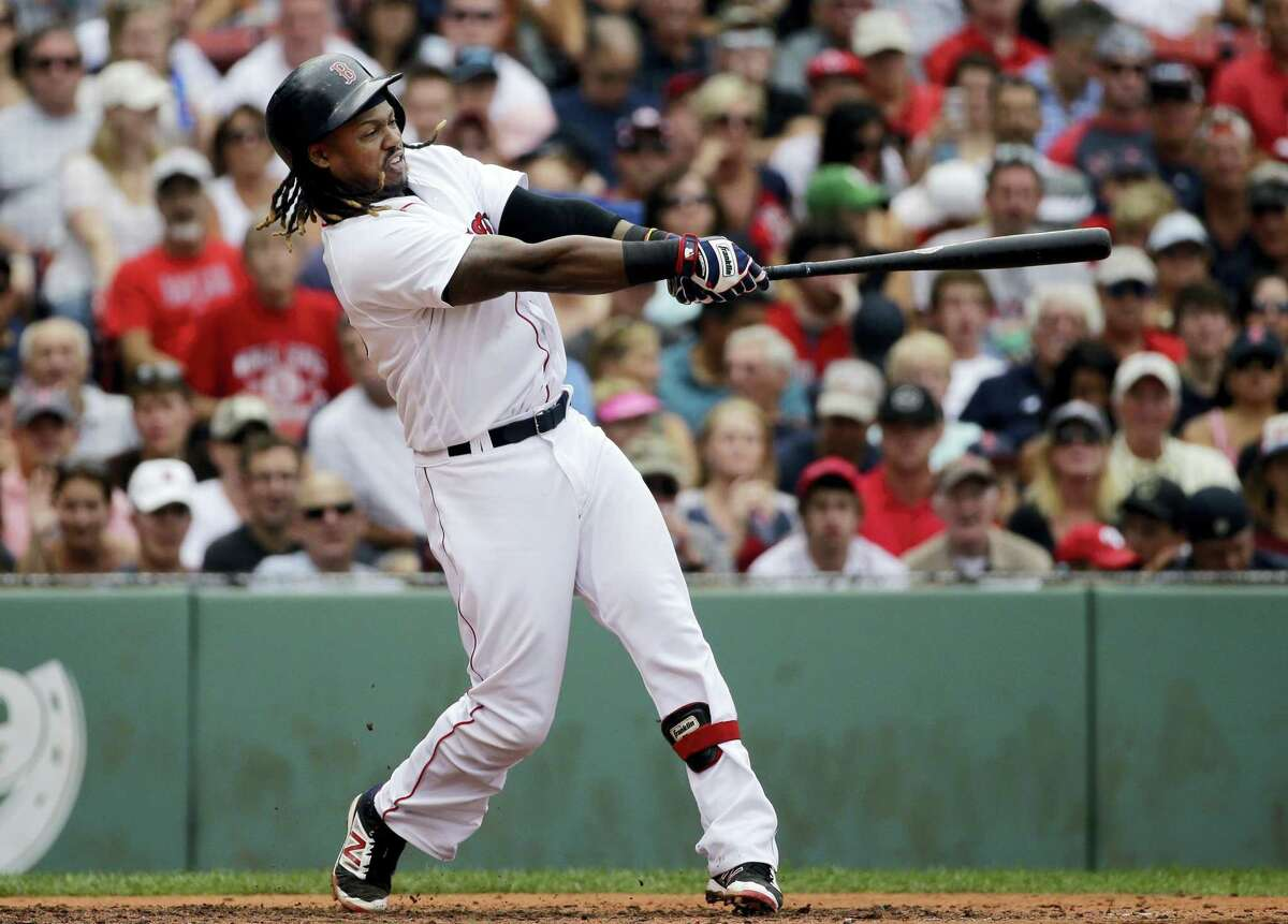 Boston's Hanley Ramirez hits a grand slam in the fifth inning against the Tampa Bay Rays at Fenway Park Wednesday. The Red Sox held on to beat the Rays 8-6.