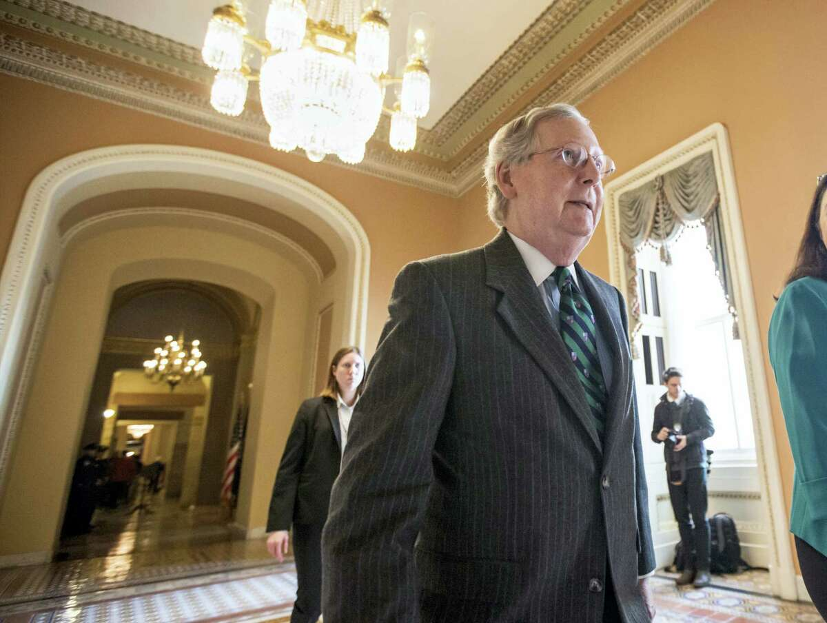 Senate Majority Leader Mitch McConnell walks to the chamber where he offered a tribute to the late Supreme Court Justice Antonin Scalia whose death has triggered an election-year political standoff, on Capitol Hill in Washington on Feb. 22, 2016.
