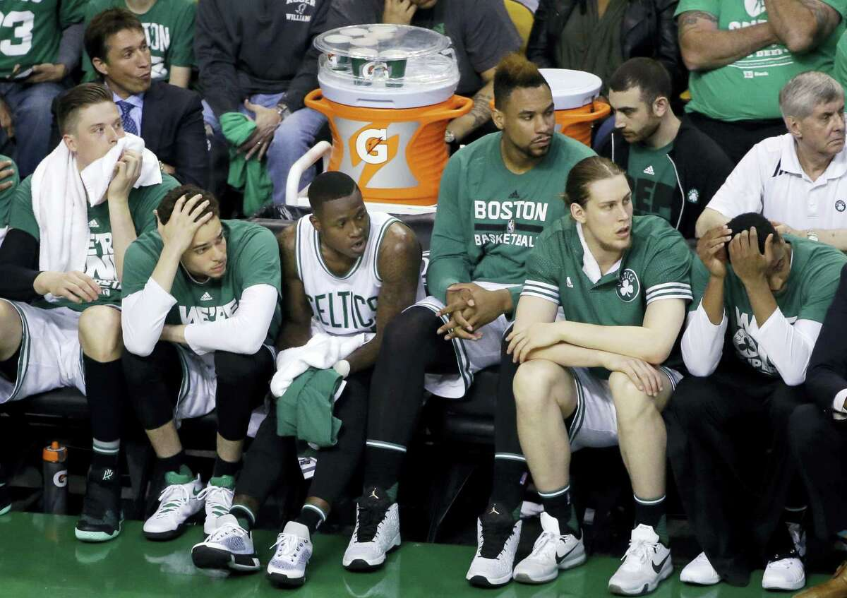 Boston Celtics players watch from the bench during the fourth quarter against the Atlanta Hawks in Game 6 Thursdayin Boston. The Hawks won 104-92 to win the series 4-2.