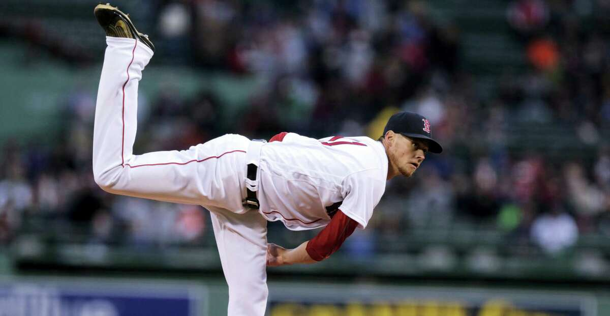 Boston Red Sox starting pitcher Clay Buchholz delivers during a baseball game at Fenway Park in Boston, Thursday, April 28, 2016. (AP Photo/Charles Krupa)