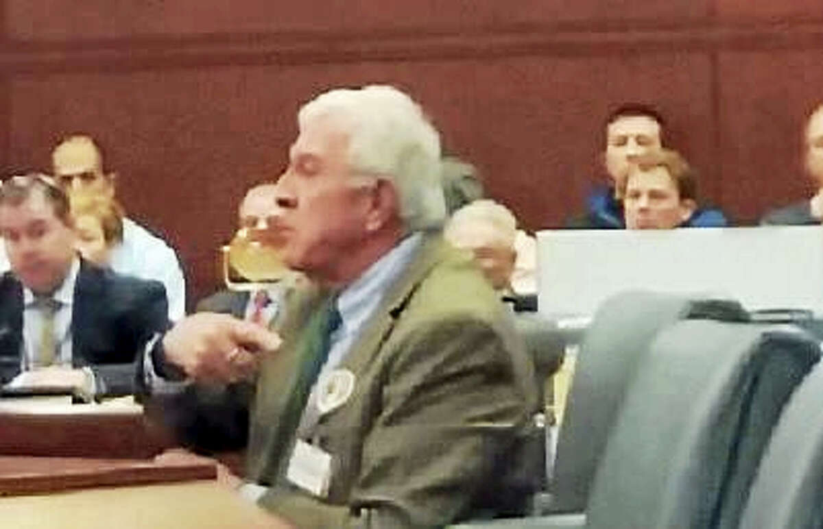 Carroll Hughes, a lobbyist for the Connecticut Package Store Association, testifying before the General Law Committee.
