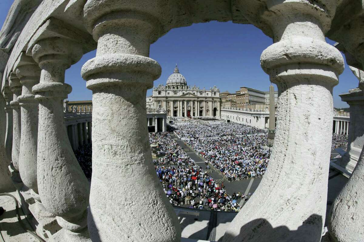 St. Peter's Square is crowded with faithful attending a Canonization Mass by Pope Francis for Mother Teresa, at the Vatican, Sunday, Sept. 4, 2016. Francis has declared Mother Teresa a saint, honoring the tiny nun who cared for the world's most destitute as an icon for a Catholic Church that goes to the peripheries to find poor, wounded souls. (AP Photo/Alessandra Tarantino)