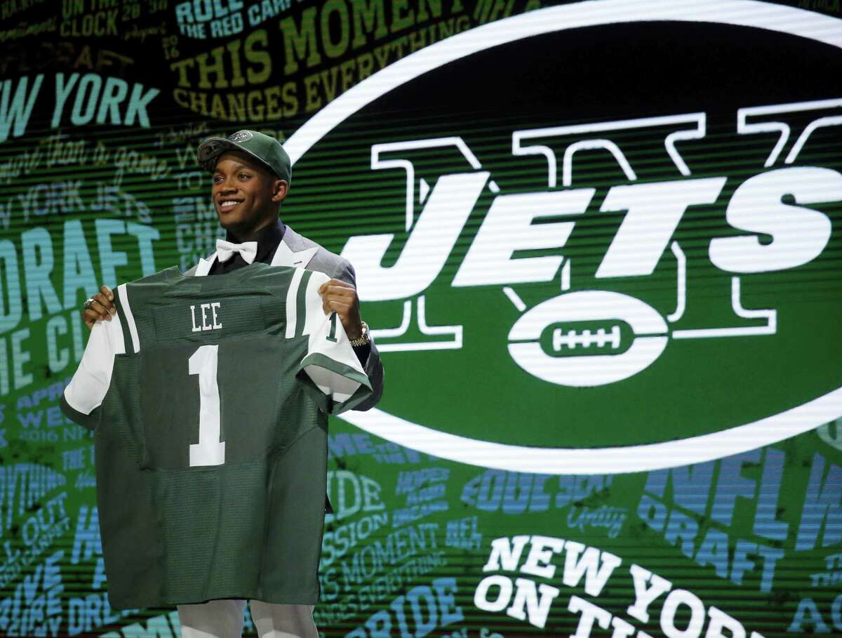 Ohio State's Darron Lee poses for photos after being selected by the New York Jets as the 20th pick in the first round of the 2016 NFL football draft, Thursday, April 28, 2016, in Chicago. (AP Photo/Charles Rex Arbogast)
