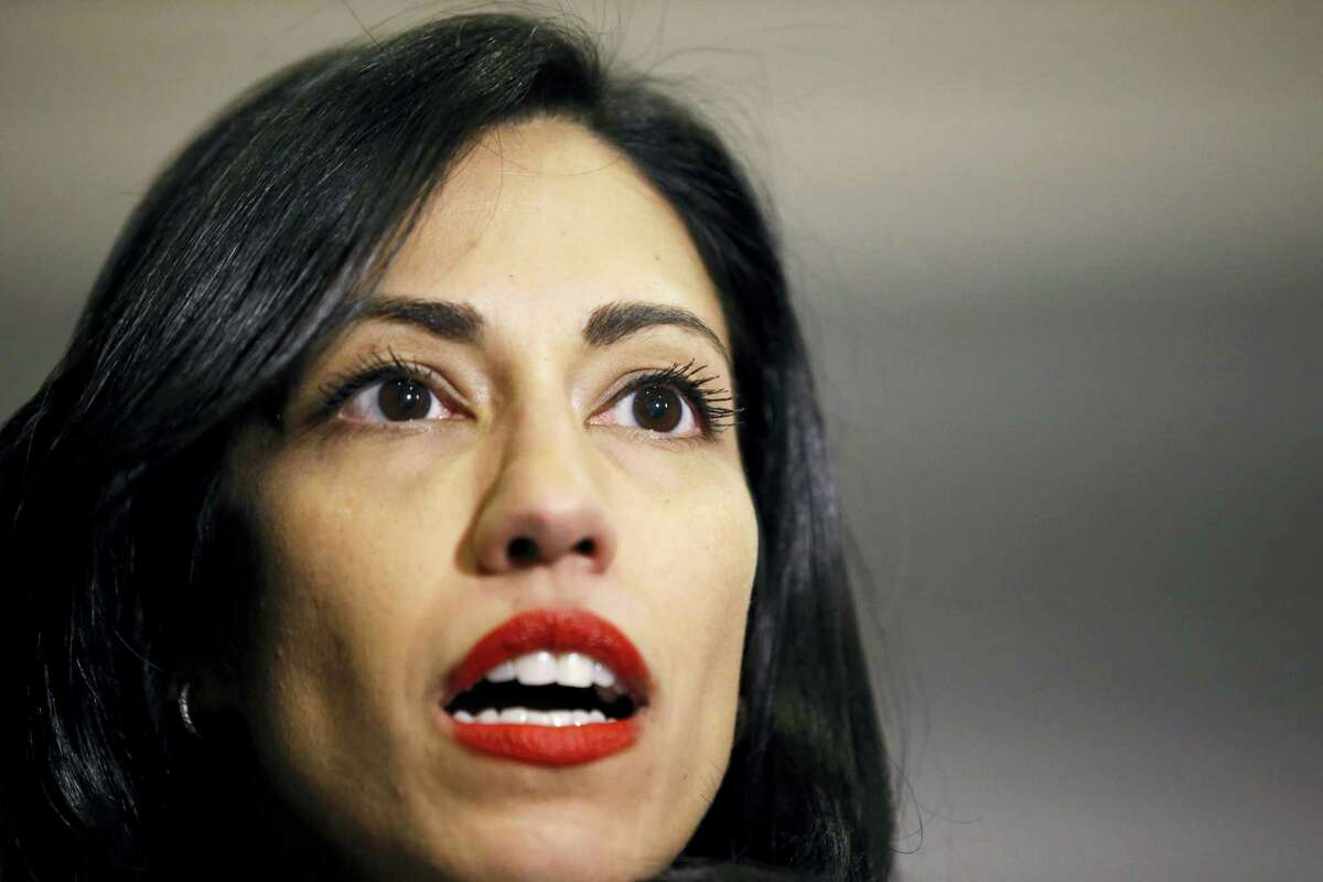 """File-This Oct. 16, 2015, file photo shows Huma Abedin, a longtime aide to Hillary Rodham Clinton, speaking to the media after testifying at a closed-door hearing of the House Benghazi Committee, on Capitol Hill, in Washington. Abedin said in a legal proceeding that Clinton did not want the State Department emails that she sent and received on her private computer server to be accessible to """"anybody,"""" according to transcripts released Wednesday, June 29, 2016. Her comments provided new insights into the highly unusual decision by the presumptive Democratic presidential candidate to operate a private email server in her basement to conduct government business as secretary of state."""