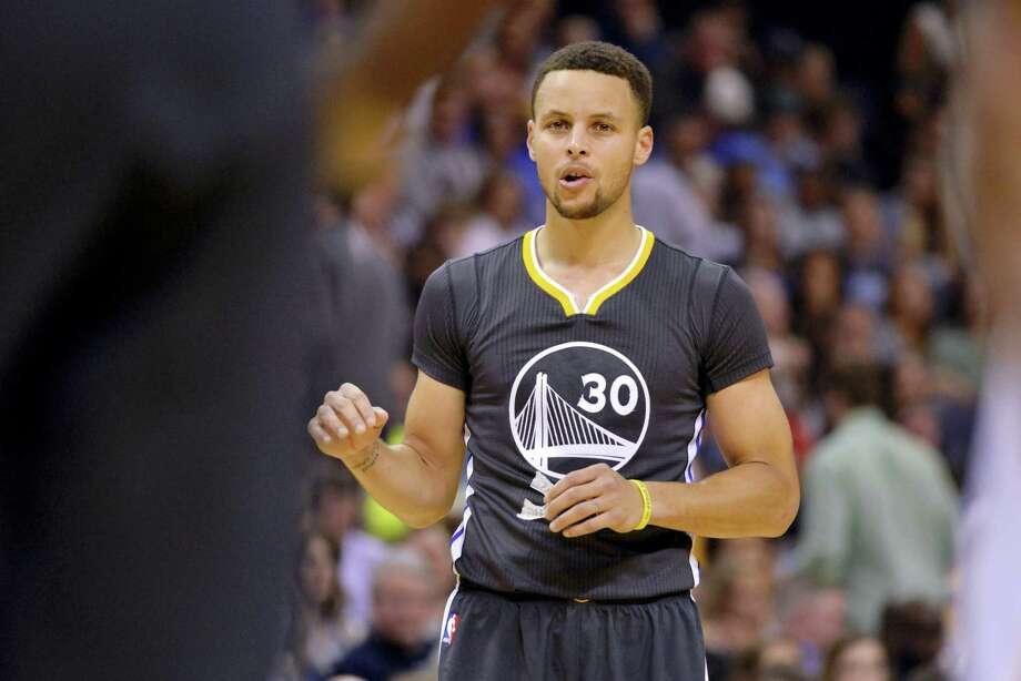 Warriors guard Stephen Curry. Photo: Brandon Dill — The Associated Press  / FR171250 AP