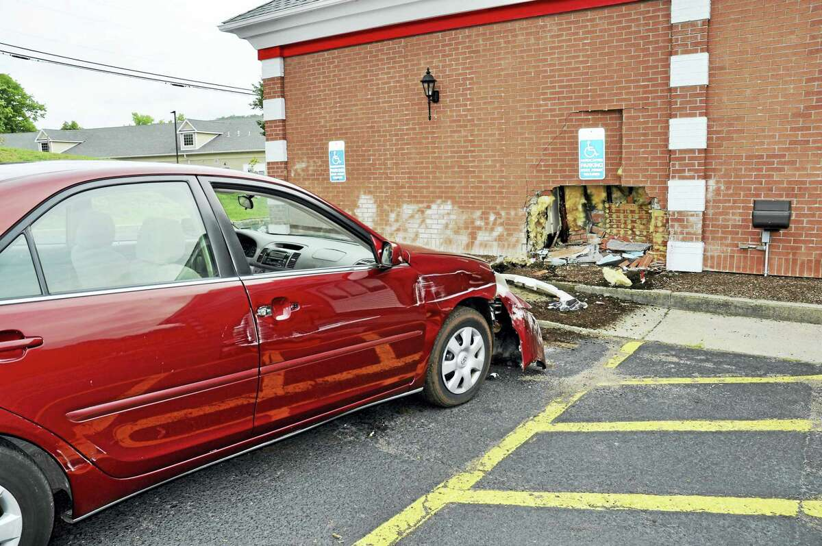 The front of a woman's sedan was damaged after she hit the side of the Friendly's restaurant in Cromwell early Wednesday.