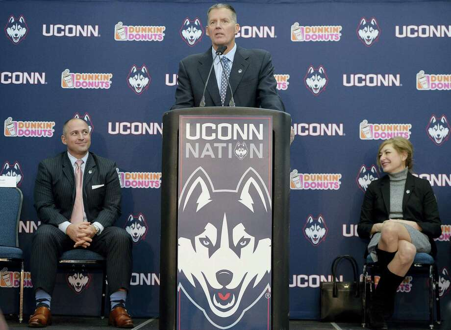 Randy Edsall speaks during a news conference as UConn athletic director David Benedict, left, and university president Susan Herbst, right, listen, at Rentschler Field on Friday. Photo: Jessica Hill — The Associated Press   / AP2016