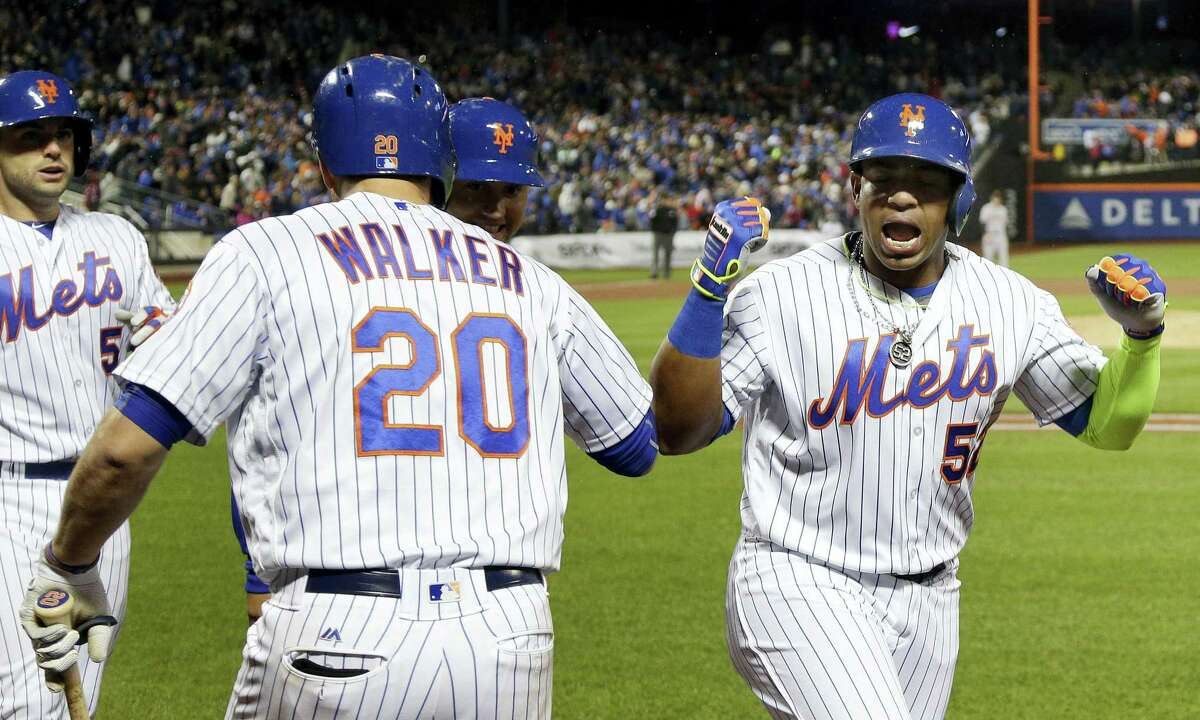 Yoenis Cespedes (52) reacts after hitting a grand slam against the Giants during the third inning on Friday.
