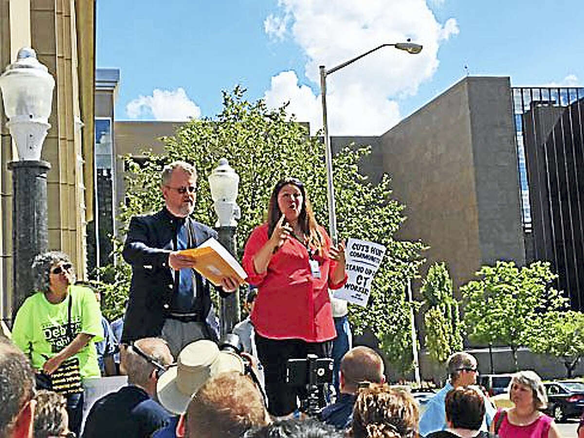 State interpreters James Cusack and Tammy Batch speak Wednesday during a rally outside the state office building at 55 Farmington Ave. in Hartfotrd.