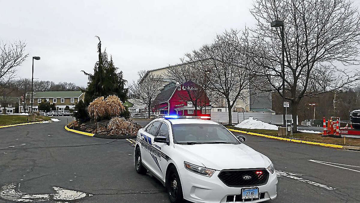 A police patrol car at Toyota Oakdale Theatre in Wallingford, the scene of a double homicide Friday night.