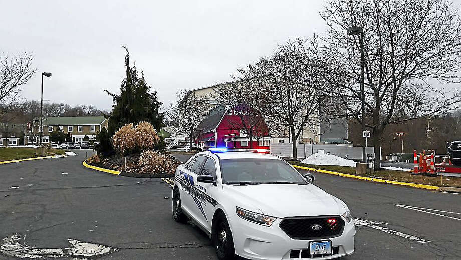 A police patrol car at Toyota Oakdale Theatre in Wallingford, the scene of a double homicide Friday night. Photo: Kate Ramunni — New Haven Register