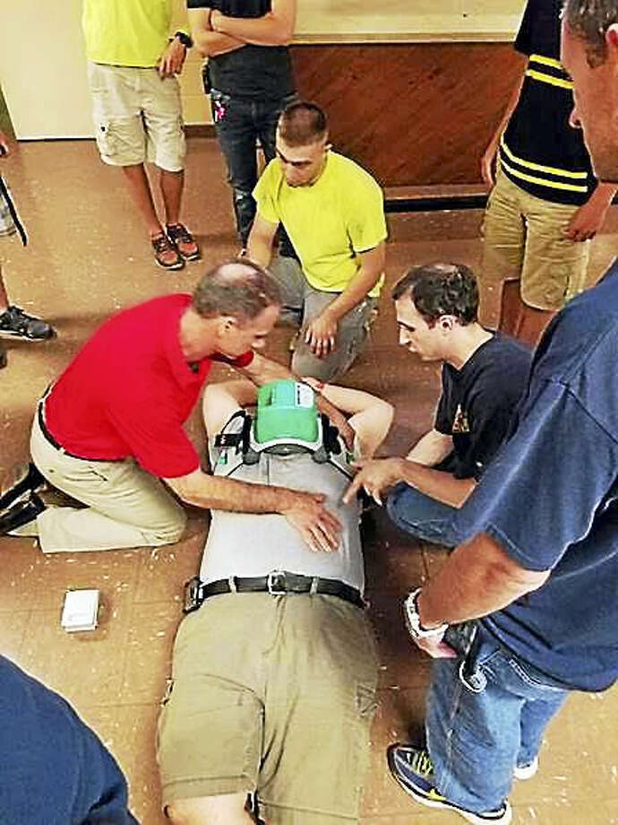 Members of the Westfield Volunteer Fire Department learn how to apply and operate the Lucas 2 mechanical chest compression device to resuscitate victims of sudden cardiac arrest. Photo: Courtesy Westfield Fire