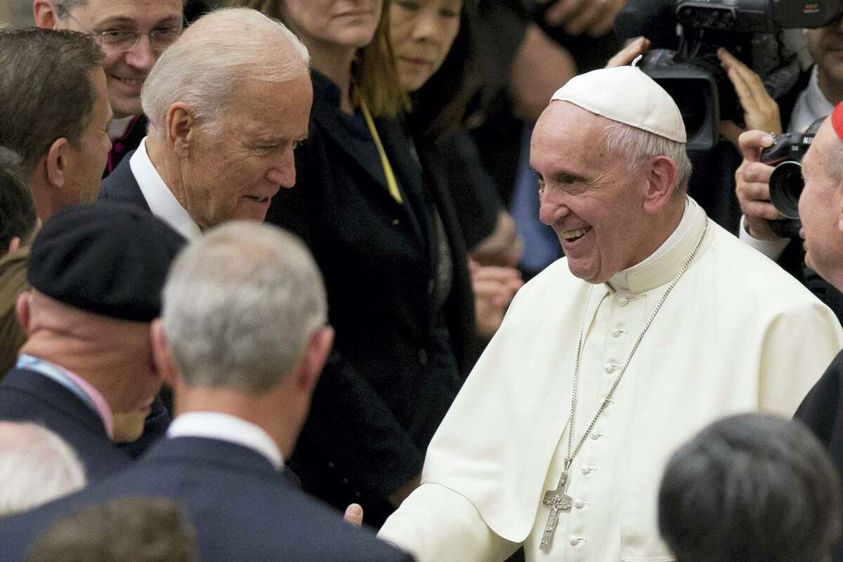 Pope Francis shakes hands with US vice president Joe Biden as he takes part in a congress on the progress of regenerative medicine and its cultural impact, being held in the Pope Paul VI hall at the Vatican, Friday, April 29, 2016.