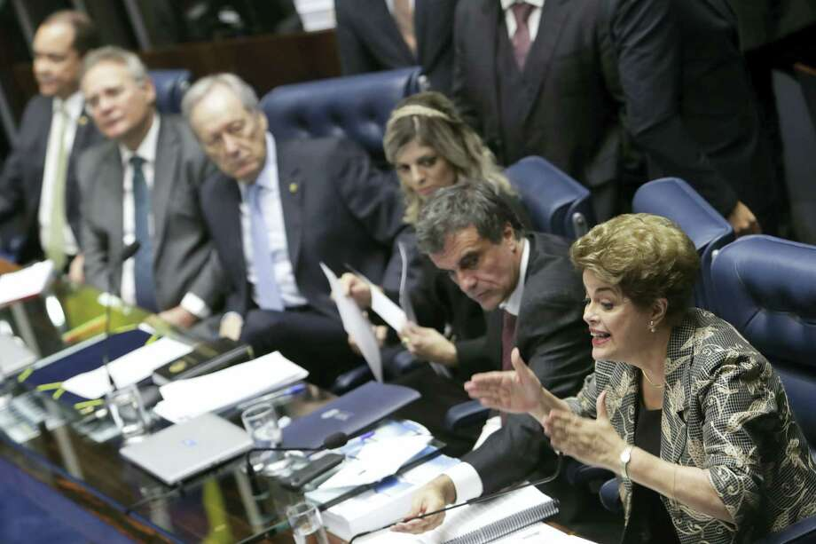 "Brazil's suspended President Dilma Rousseff speaks at her own impeachment trial, in Brasilia, Brazil, Monday, Aug. 29, 2016. Fighting to save her job, Rousseff told senators on Monday that the allegations against her have no merit. ""I know I will be judged, but my conscience is clear. I did not commit a crime,"" she told senators. Rousseff's address comes on the fourth day of the trial. (AP Photo/Eraldo Peres) Photo: AP / Copyright 2016 The Associated Press. All rights reserved. This material may not be published, broadcast, rewritten or redistribu"