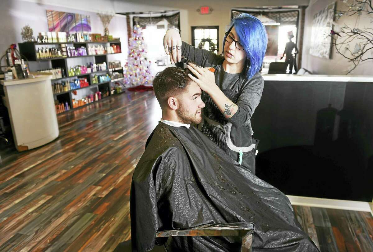 Arnold Gold — New Haven Register Kelly Alexander cuts the hair of Dylan Morano of Westbrook at Silhouettes Hair Salon in Old Saybrook, a client of Shoreline Perks.