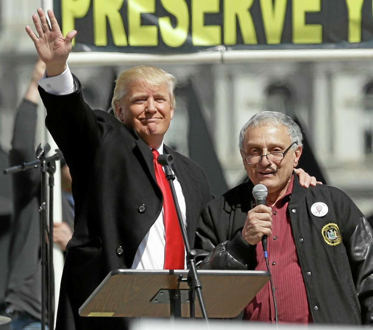 Donald Trump, left, and Carl Paladino, who ran for governor of New York as a Republican in 2010, speak during a gun rights rally at the Empire State Plaza on Tuesday, April 1, 2014, in Albany, Mike Groll — AP Photo