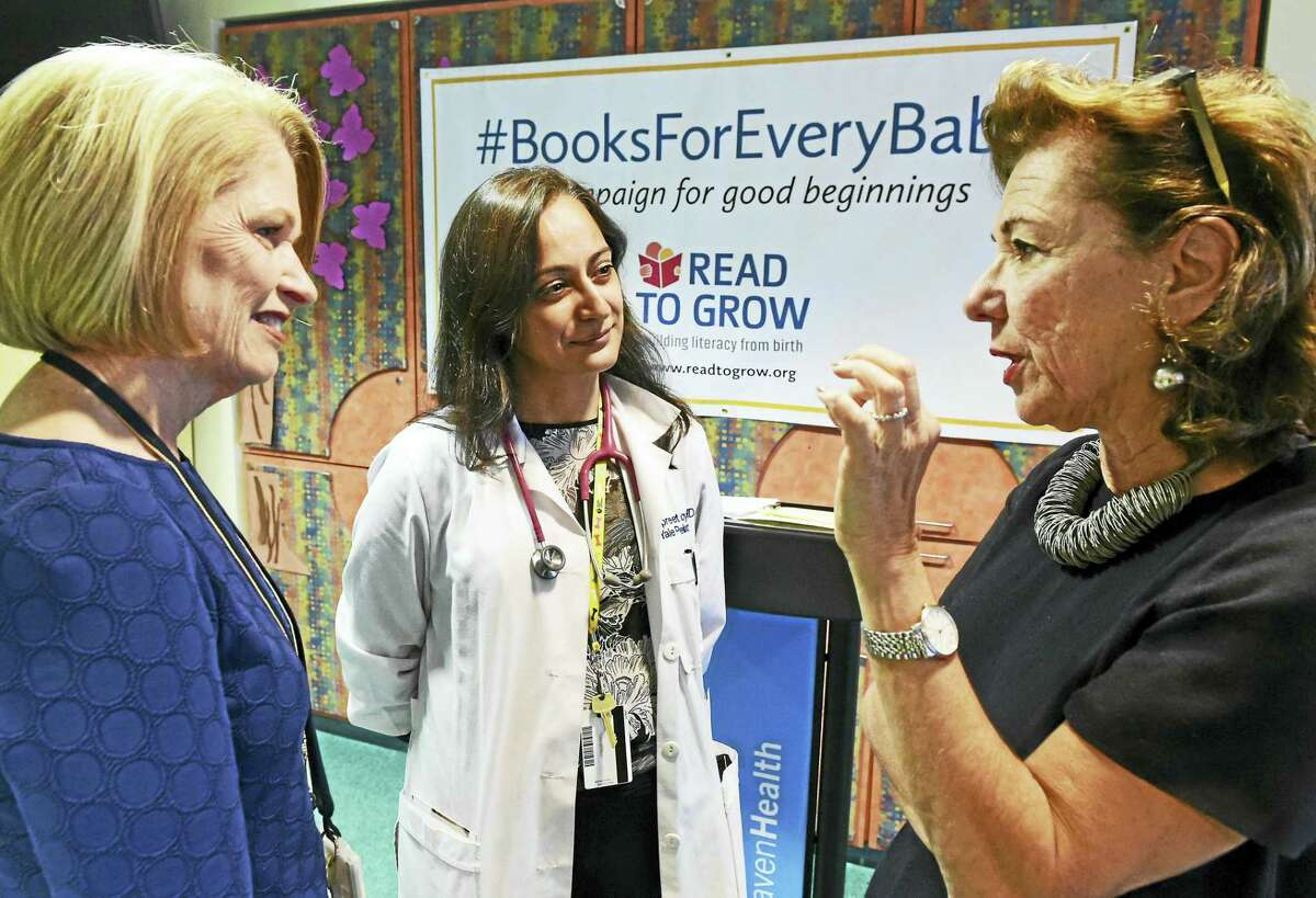 From left, Marna Borgstrom, president and CEO of Yale New Haven Health, Dr. Jaspreet Loyal, medical director of the Yale-New Haven Hospital well newborn nursery, and Roxanne Coady, owner of R.J. Julia Booksellers in Madison and board chairwoman of Read to Grow.