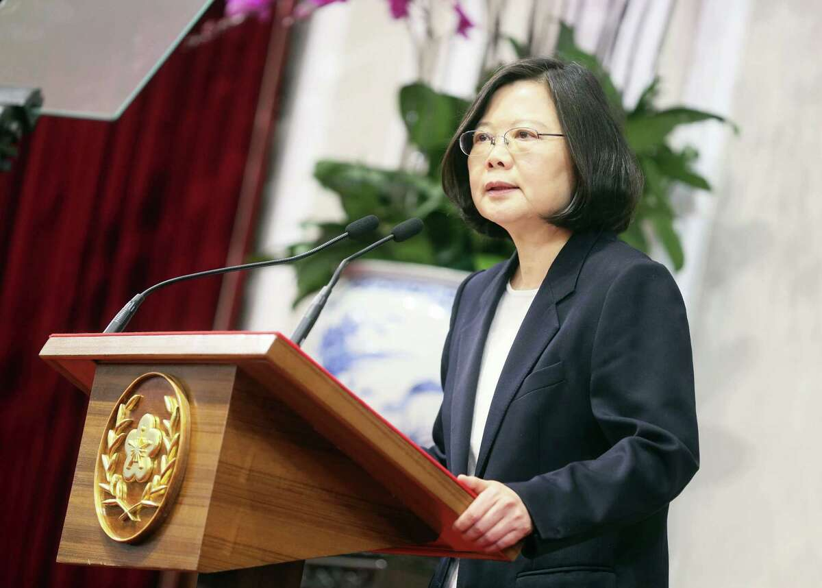 """In this photo released by the Taiwan Presidential Office, President Tsai Ing-wen delivers a year-end speech during an international press conference at the presidential office, Saturday, Dec. 31, 2016, in Taipei, Taiwan. President Tsai urged China to engage in """"calm and rational"""" dialogue to maintain peace, vowing not to give in to Beijing's recent moves to """"threaten and intimidate"""" the self-ruled island."""