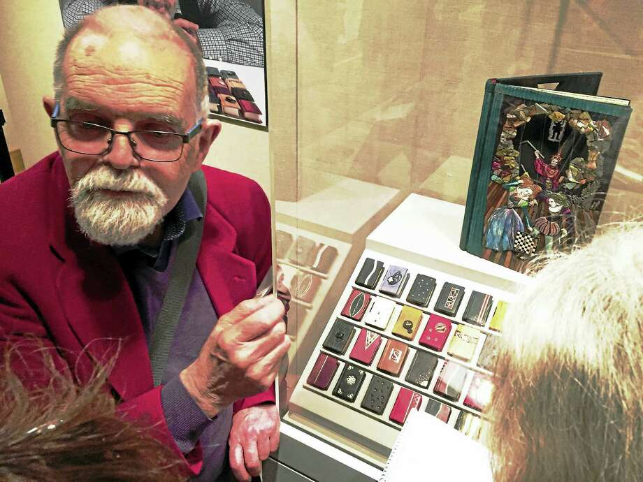 George Kirkpatrick with his award-winning binding, top right, and other binders' mini-books. Photo: Joe Amarante — Register