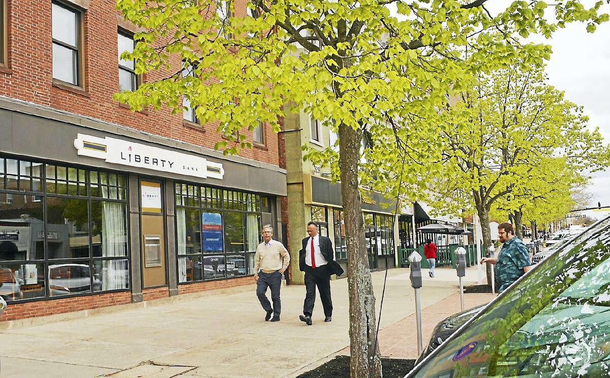 Wesleyan University president Michael Roth walks along Middletown's Main Street Friday afternoon.