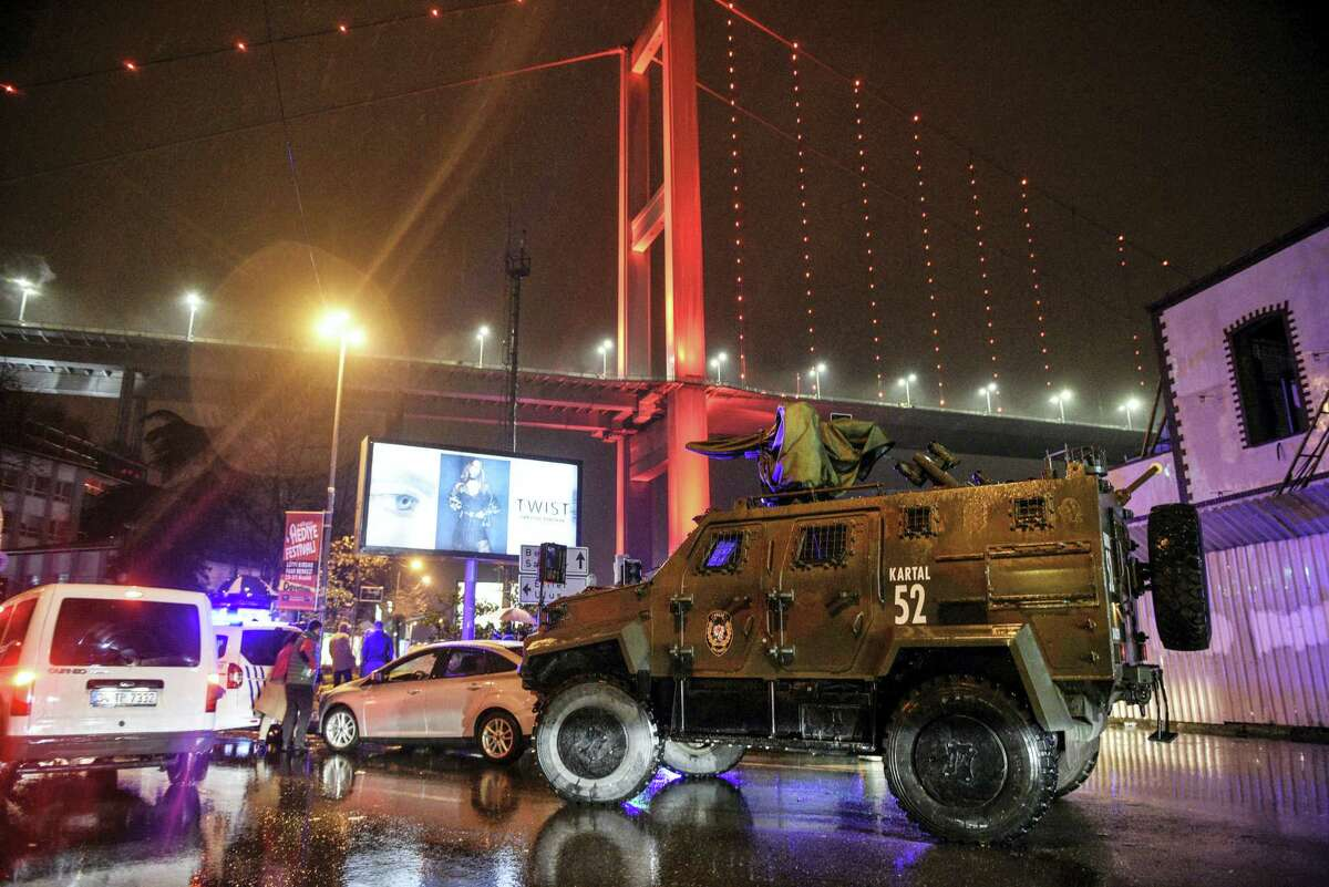 A police armored vehicle blocks the road leading to the scene of an attack in Istanbul, early Sunday, Jan. 1, 2017. Private NTV television said more than one assailant may have been involved in the attack. The attacker or attackers are believed to have entered the nightclub in Istanbul's Ortakoy district disguised as Santa Claus, the station reported.