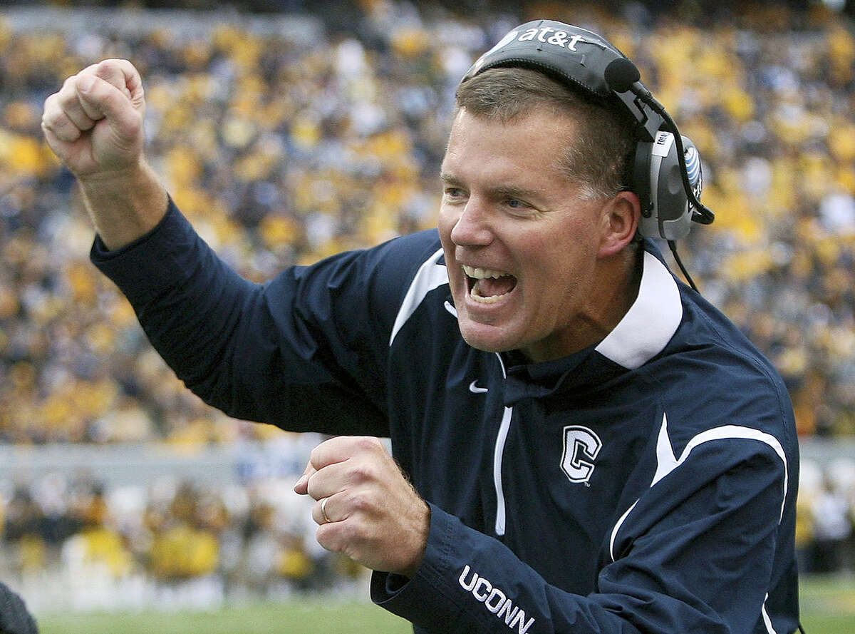 In this file photo, Connecticut head coach Randy Edsall, greets a player after his team scored against West Virginia. UConn introduced Edsall as its coach Friday.