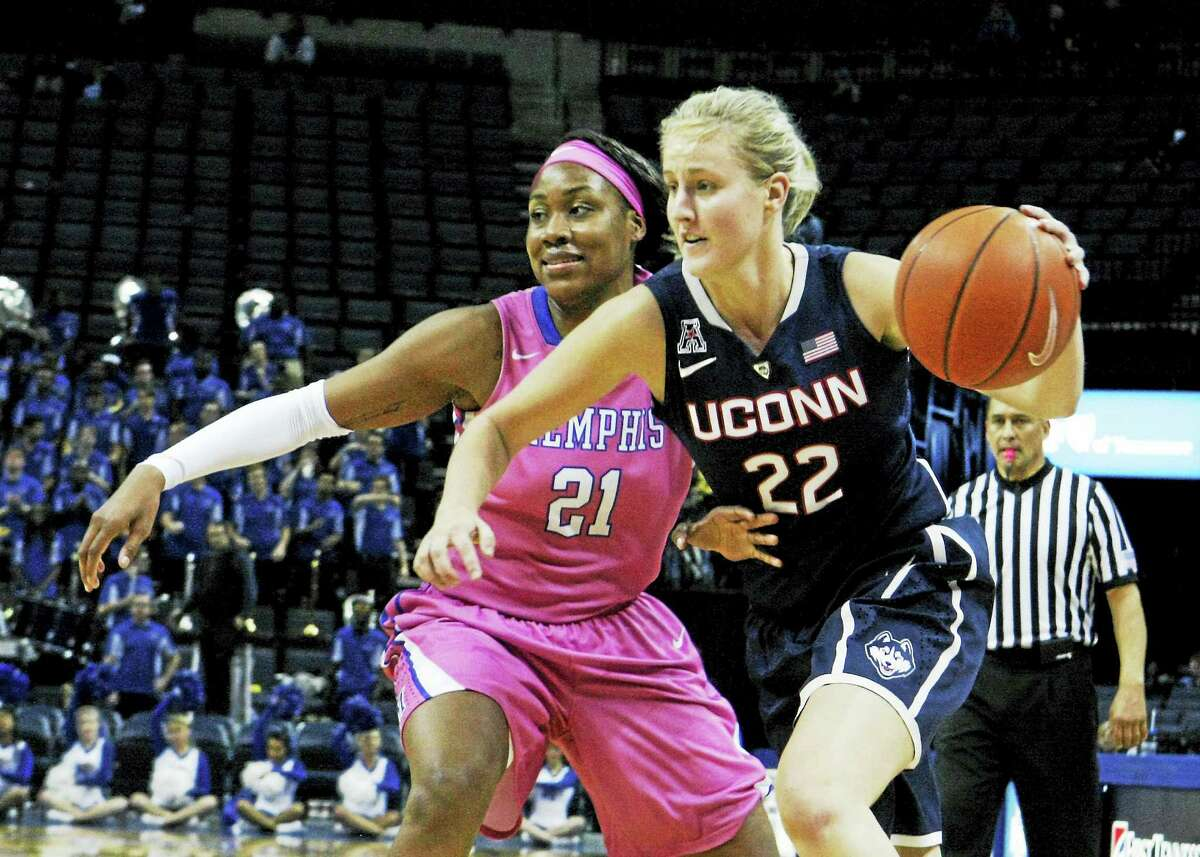 Connecticut's Courtney Ekmark (22) drives past Memphis' Asianna Fuqua-Bey (21) in the second half of a Feb. 7, 2015 game in Memphis, Tenn.