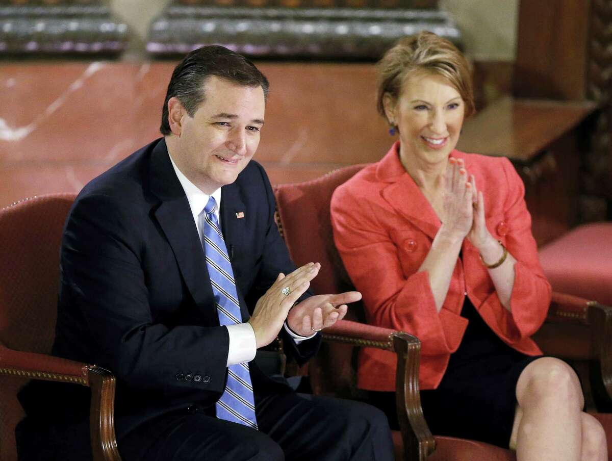 Republican presidential candidate, Sen. Ted Cruz, R-Texas, and vice-presidential candidate Carly Fiorina applaud during a question and answer session with Fox News Channel's Sean Hannity at The Indiana War Memorial Friday, April 29, 2016, in Indianapolis.