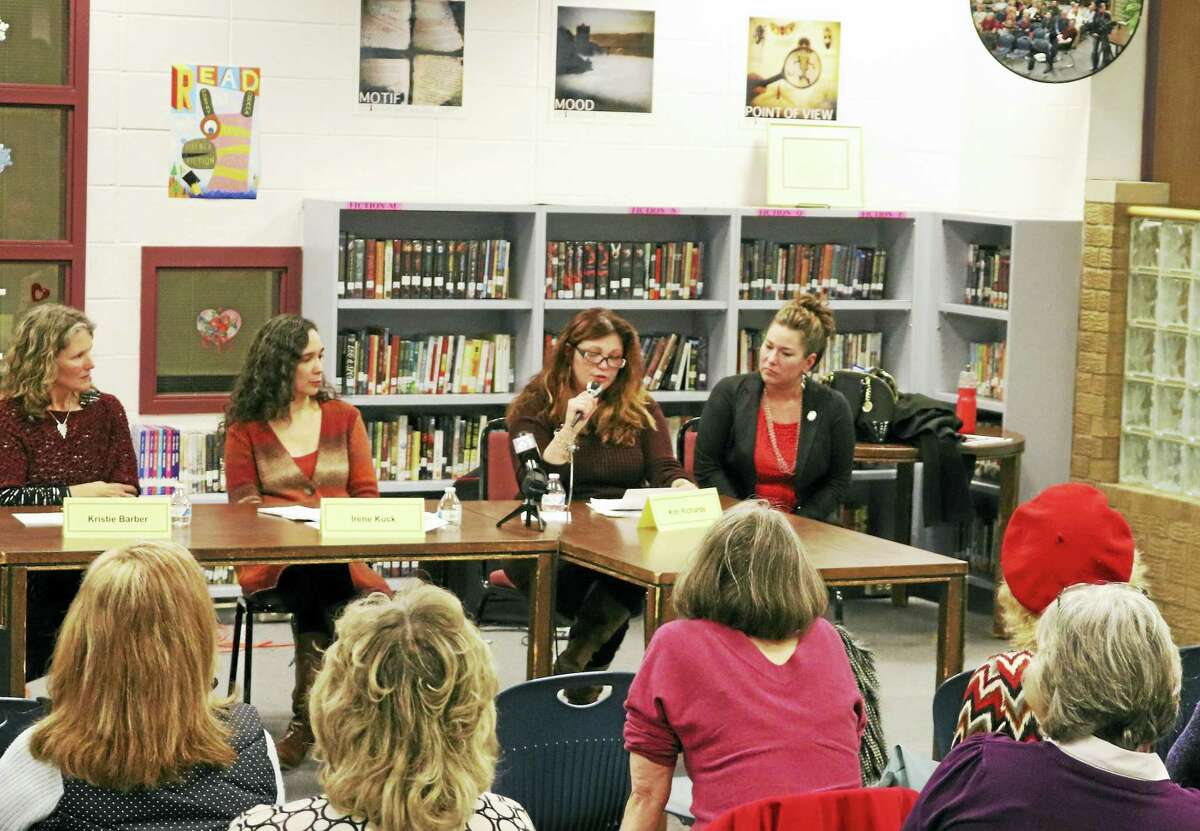 Panelists at the heroin and opioids information session on Friday night speak to a large crowd. From left are Kristie Barber, executive director of South Central Regional Mental Health Board, Irene Kuck; chairperson of East Hampton Local Prevention Council; Kim Richards of East Hampton and state Rep. Melissa Ziobron.