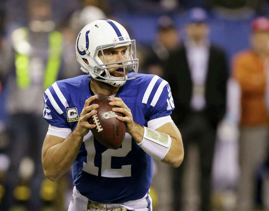 FILE - In this Nov. 8, 2015, file photo, Indianapolis Colts' Andrew Luck (12) looks to throw during the second half of an NFL football game against the Denver Broncos, in Indianapolis. Luck has signed a new contract with the Indianapolis Colts that covers the next six seasons through 2021. The $140 million deal was completed Wednesday. Photo: MICHAEL CONROY — THE ASSOCIATED PRESS  / Copyright 2016 The Associated Press. All rights reserved. This material may not be published, broadcast, rewritten or redistribu