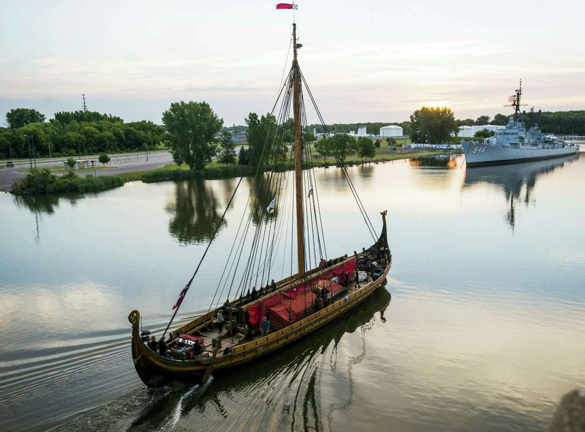 In this July 19, 2016, file photo, The Draken Harald Harfagre departs Bay City, Mich., on the Saginaw River. The Viking ship is heading down the Erie Canal the weekend of Sept. 3. The 114-foot-long Draken sailed from Norway to North America this summer. The hand-built wooden ship has a stunning red sail and a carved dragon figurehead, but they had to be taken down so the craft could pass under bridges over the canal.