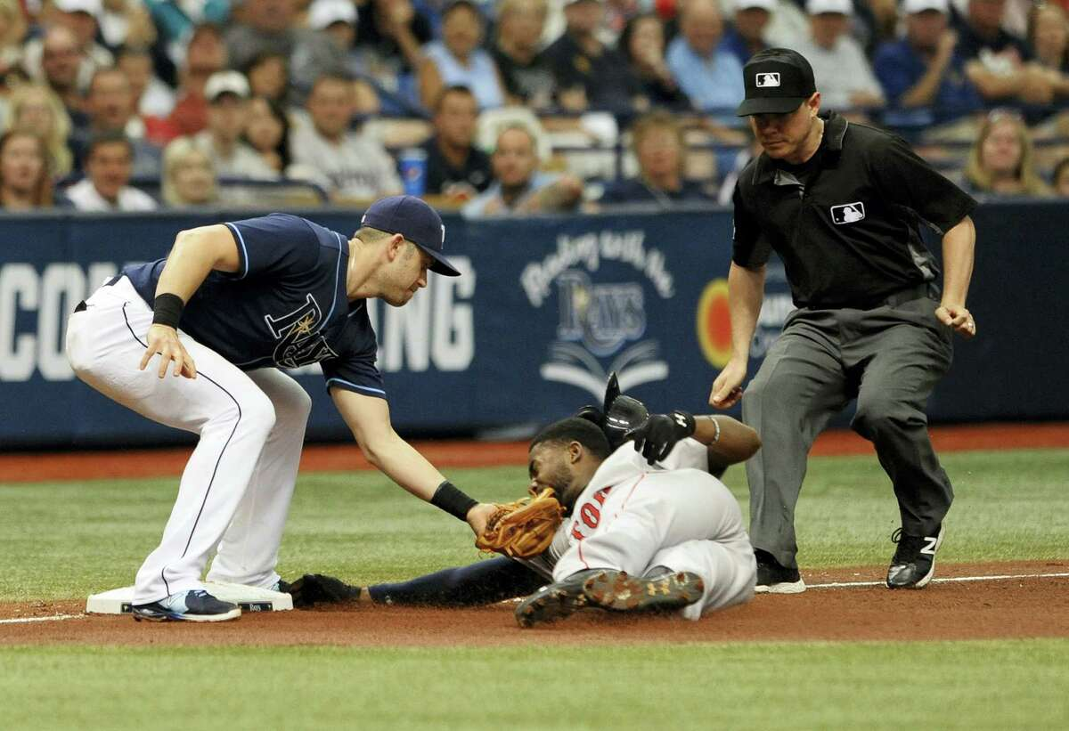 Umpire D.J. Reyburn, right, looks on as Tampa Bay's Evan Longoria, left, tags out Boston Red Sox' Jackie Bradley Jr. on a stolen base attempt during the fifth inning Wednesday at Tropicana Field.