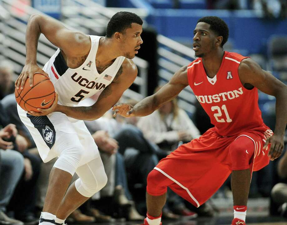 UConn's Vance Jackson, left, keeps the ball from Houston's Damyean Dotson during their game on Wednesday. Photo: Jessica Hill — The Associated Press   / AP2016