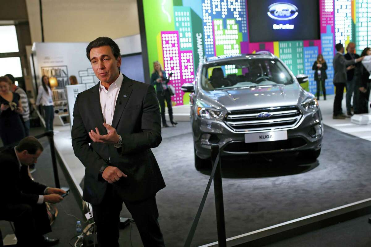 Ford CEO Mark Fields talks during an interview next to the new Kuga SUV car, which features its latest connectivity and driver-assisted technology, during the Mobile World Congress Wireless show, the world's largest mobile phone trade show, in Barcelona, Spain on Feb. 22, 2016.