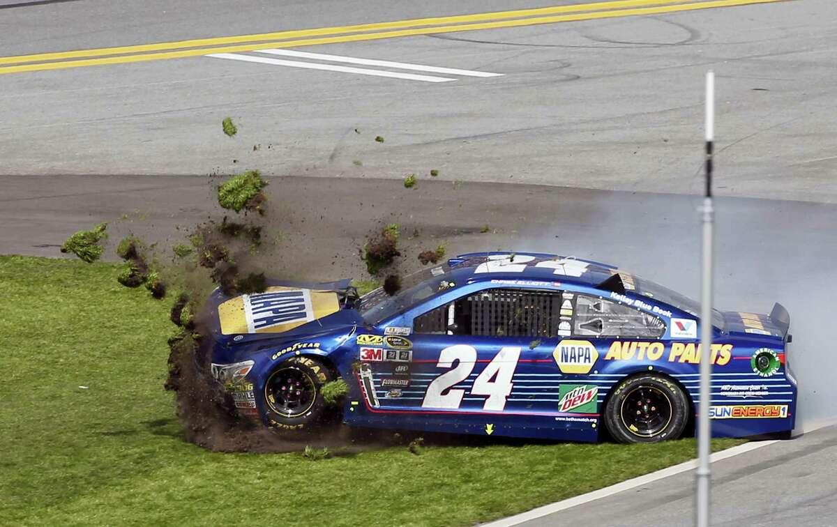 Chase Elliott (24) crashes during the NASCAR Daytona 500 auto race at Daytona International Speedway on Feb. 21, 2016, in Daytona Beach, Fla.