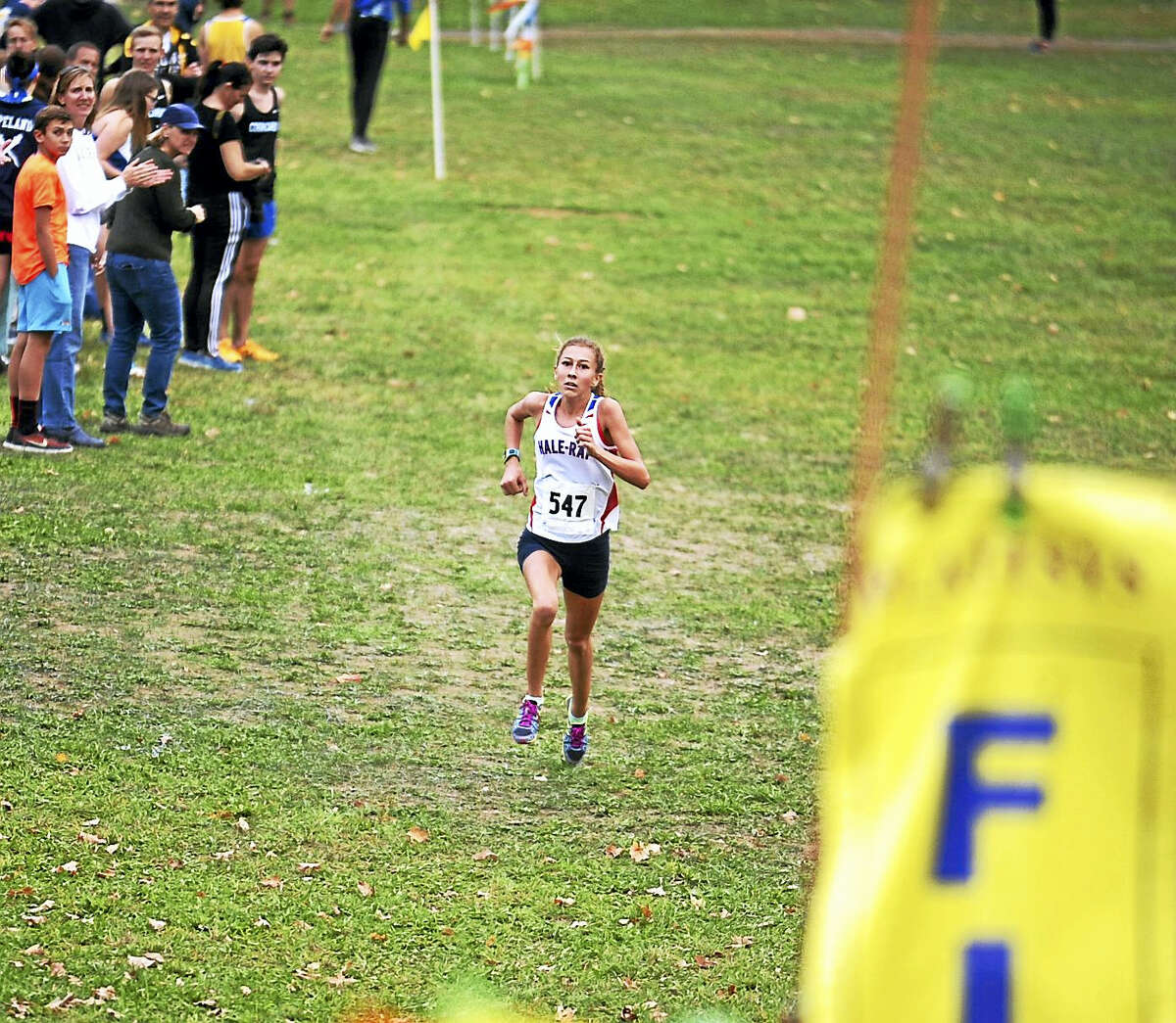 East Hampton's Emily Sienna is all alone as she approaches the finish line during the Shoreline Conference cross country championship meet.