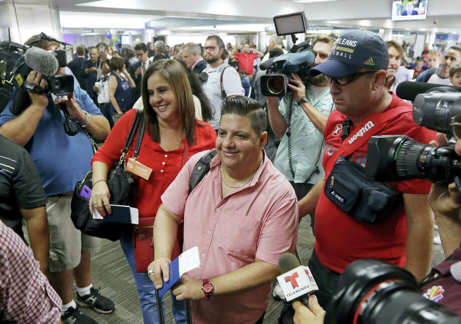 Passengers prepare to board JetBlue flight 387 to Santa Clara, Cuba on Aug. 31, 2016, at the Fort Lauderdale-Hollywood International Airport in Fort Lauderdale, Fla. The first commercial flight between the United States and Cuba in more than a half century flew out of Fort Lauderdale for the central city of Santa Clara on Wednesday morning, re-establishing regular air service severed at the height of the Cold War. Photo: AP Photo/Alan Diaz  / Copyright 2016 The Associated Press. All rights reserved.