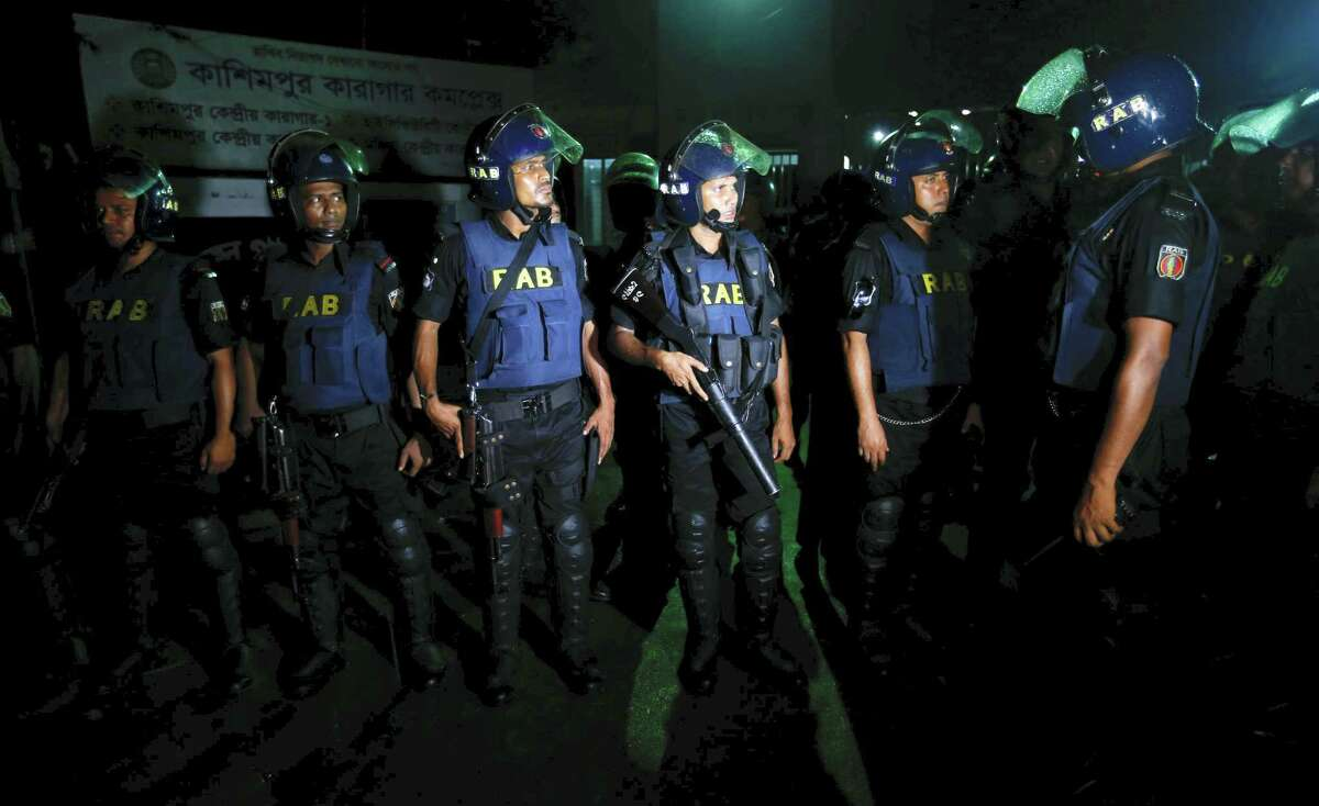 Bangladeshi security personnel stand guard in front of Kashimpur Central Jail where Mir Quasem Ali, a senior leader of the main Islamist party Jamaat-e-Islami, is being held, in Gazipur, on the outskirts of Dhaka, Bangladesh, Saturday, Sept. 3, 2016. Bangladesh's Supreme Court on Tuesday rejected a final appeal by the top Islamist party leader convicted of war crimes in the country's independence war against Pakistan, confirming a death sentence handed down earlier by a special tribunal.